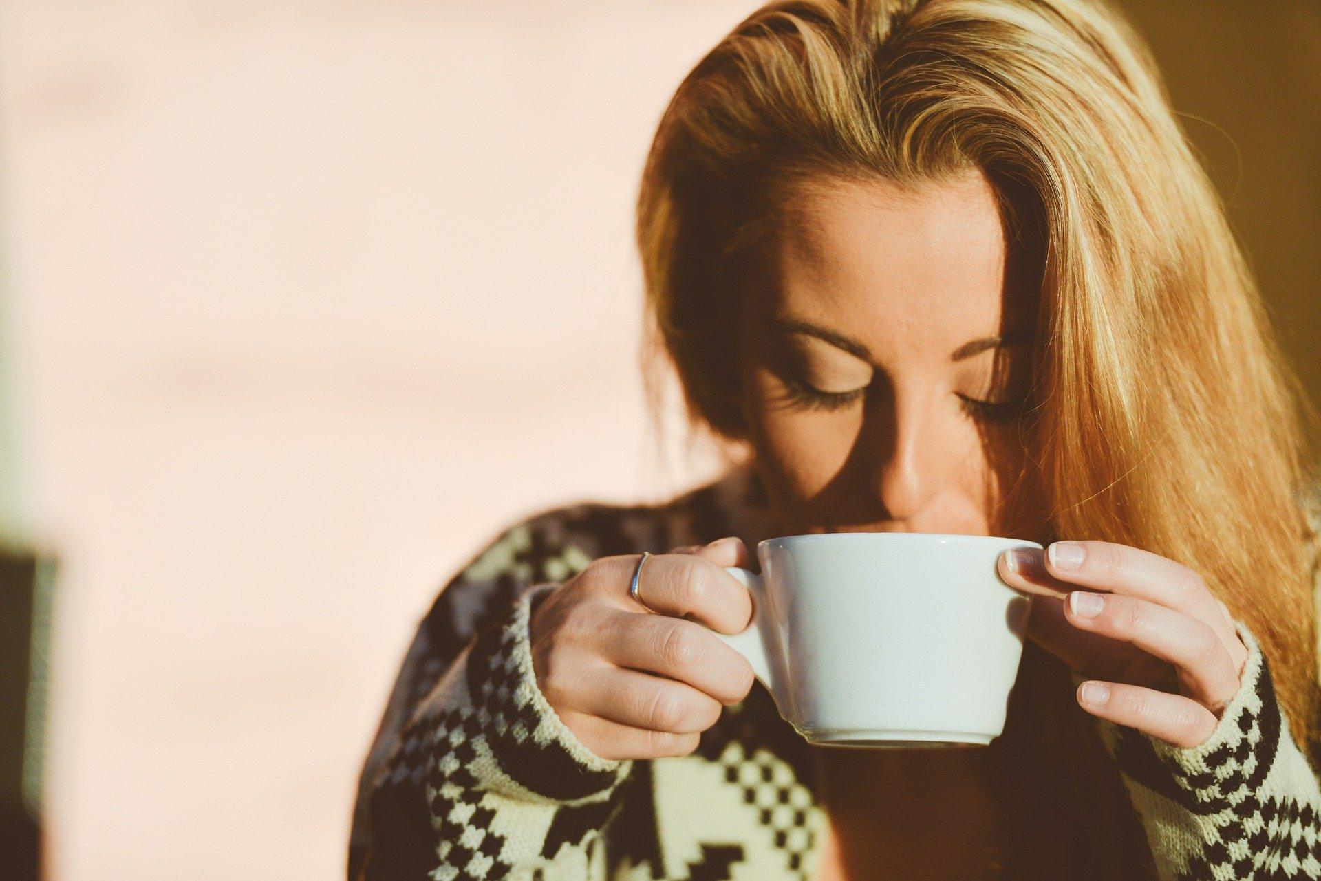 customer satisfaction - woman drinking coffee